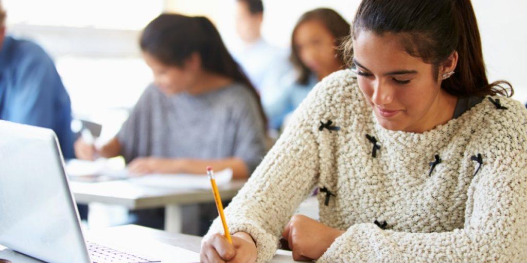 Girl doing an assignment in a classroom.